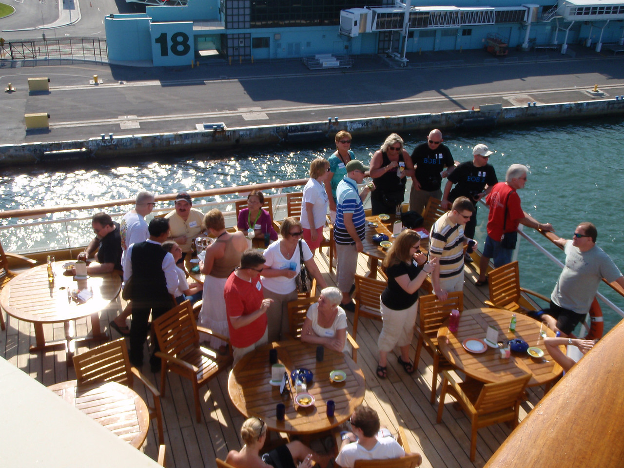 The Cruise Critics on the smoking side of the bar watch Oasis of the Seas sail away.