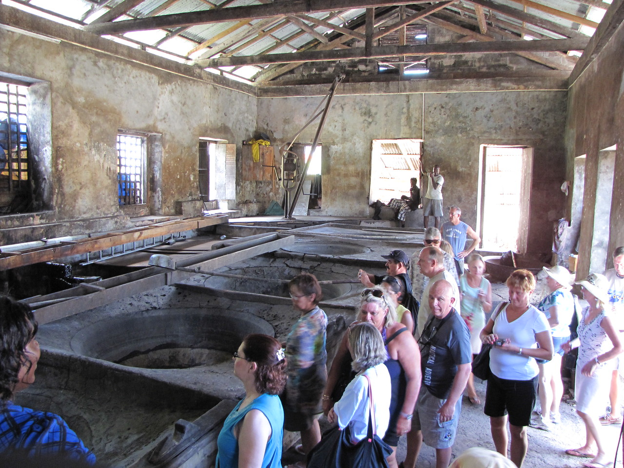 We then go inside where the cane juice is boiled in large metal basins.
