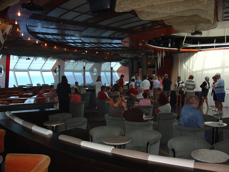 Folks gather in the Bar at the Edge of the Earth for the Cruise Critic party