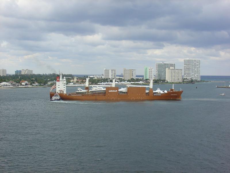 Ship hauling yachts
