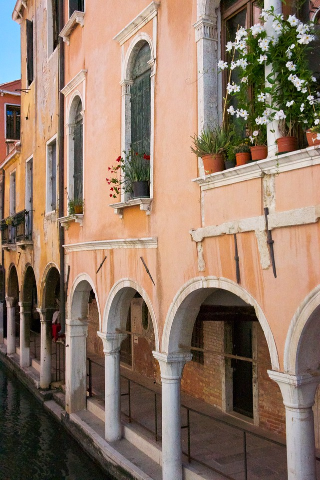 This is very near the Jewish ghetto. It is very common for people to grow flowers on the window sills since they don't have yards or gardens.