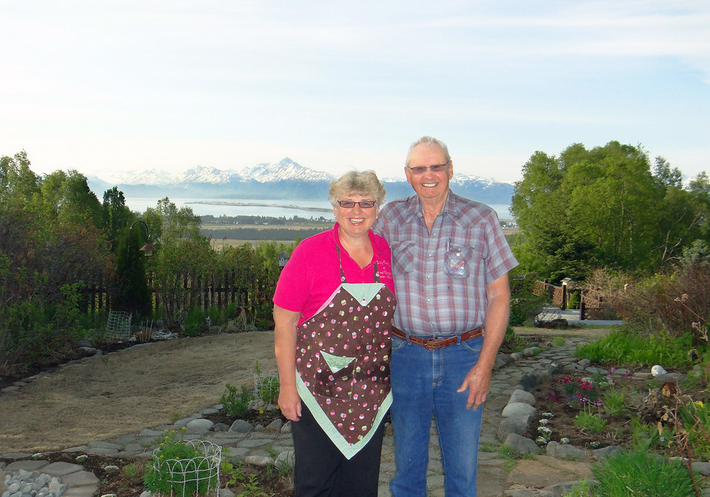 Rosie and Erless Burgess, owners of A Rosy Outlook B&B where we stayed in Homer.  You can see the spit in the background.