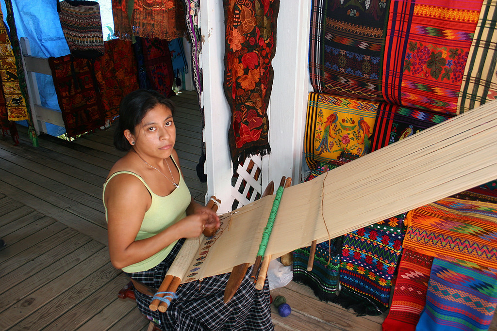 Young woman weaving at Las Palmas