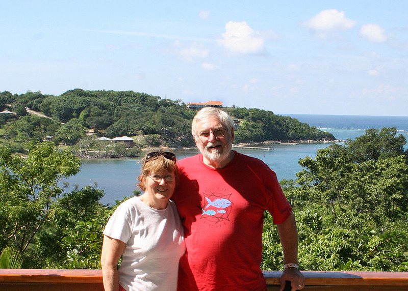 Mike and Susan with a view of a beautiful bay from Marble Hill Farms