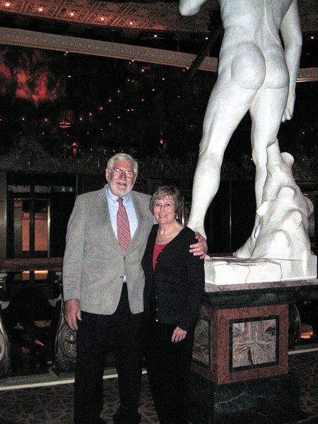 Mike and Susan in front of the statue, David, at the dinner club, David's, on board the ship