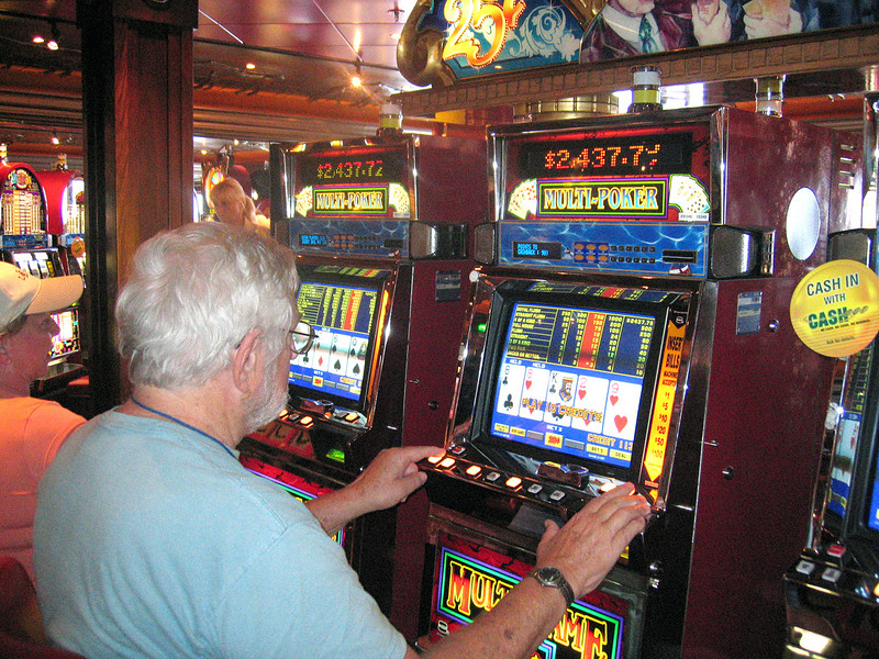 Mike winning his fame and fortune at one of the slot machines on board ship