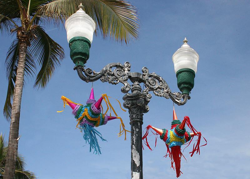 Pinatas hanging from lamppost