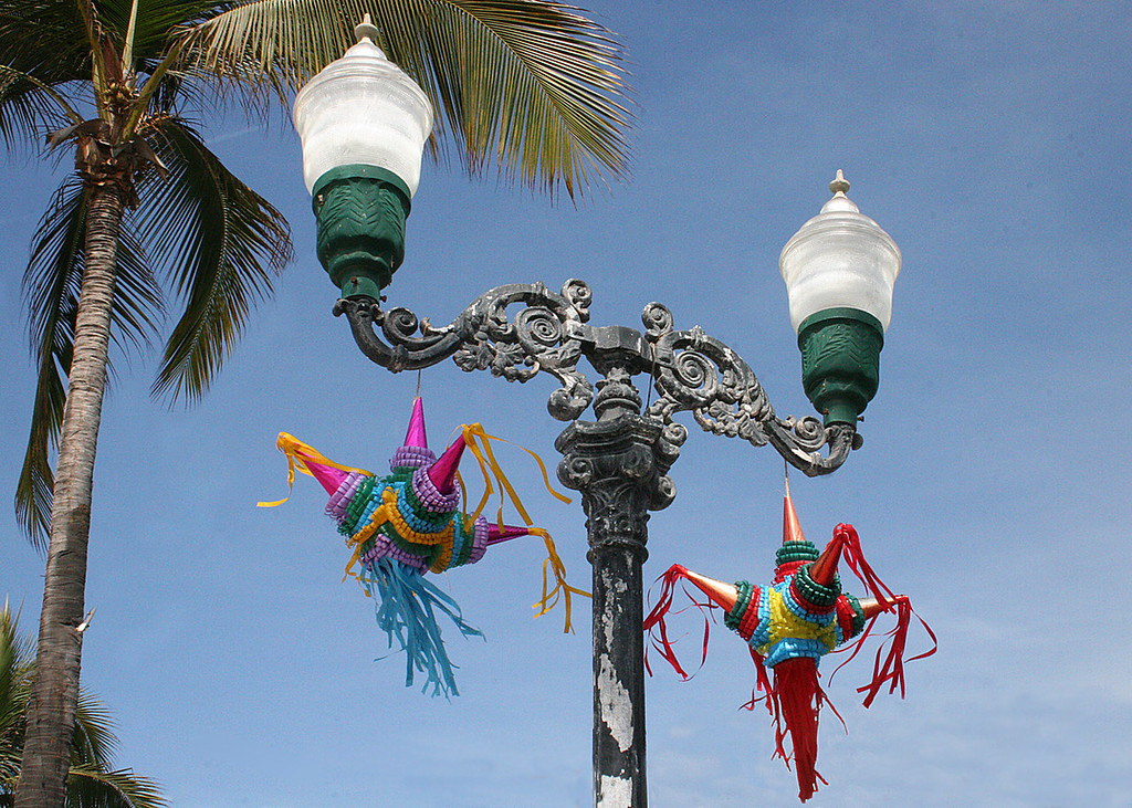 Pinatas hanging from lamppost