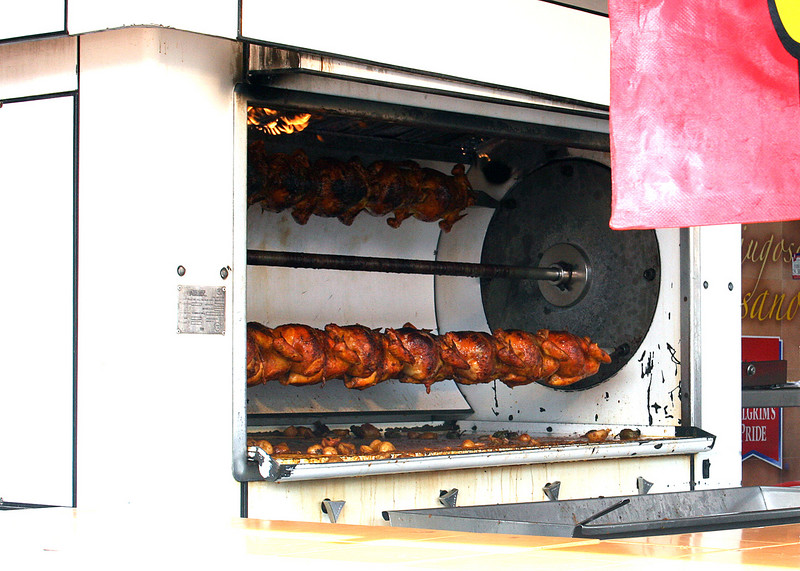Chicken roasting along street in Old Town