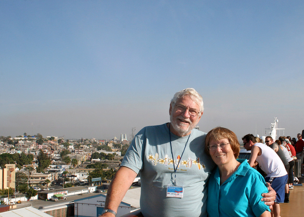 Mike and Susan on deck with Mazatlan in background