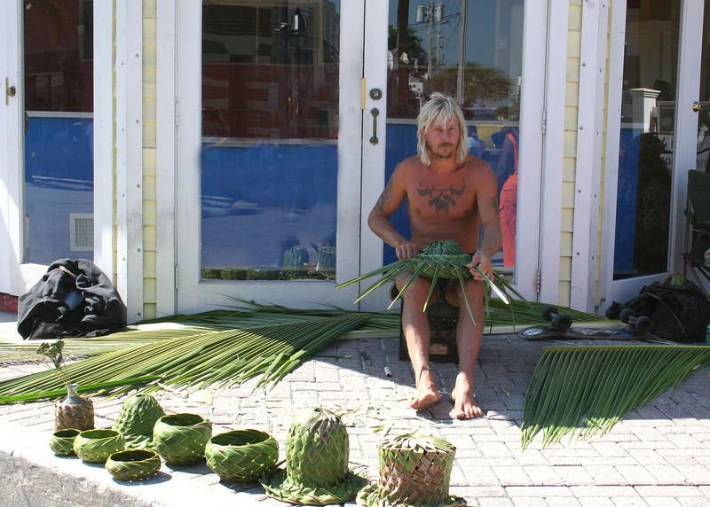 Man weaving hats in Key West.