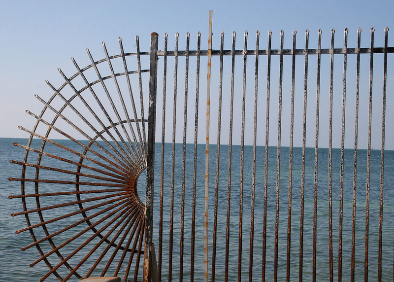 A fence at the southernmost point of the continental USA.