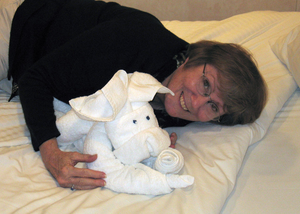 Susan snuggled with a bunny towel animal.