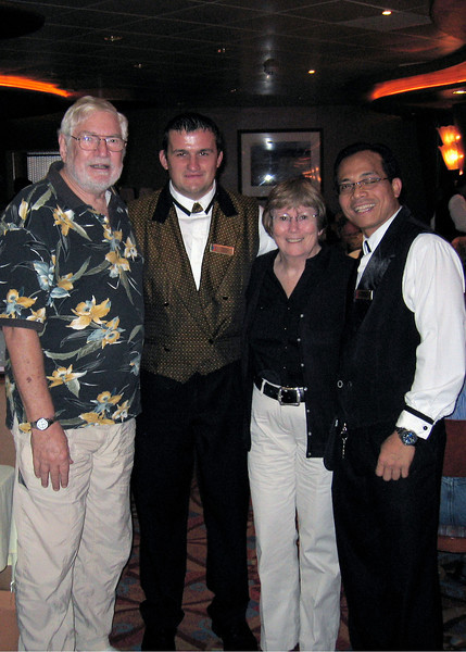 Mike and Susan with our waiters.  Sumi, on the far right, is from Bali and has invited us to visit him there someday.
