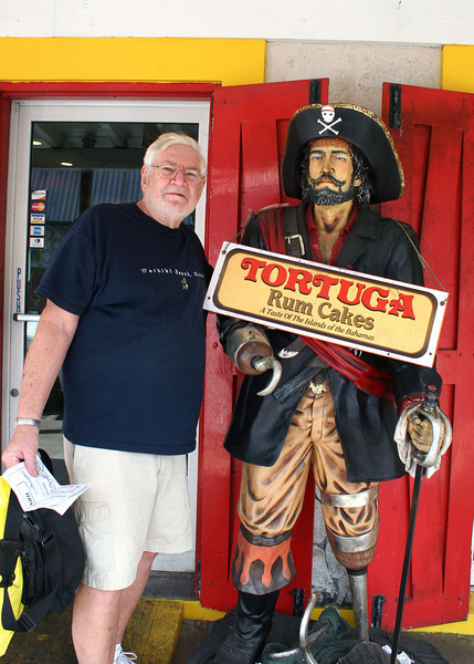 Mike with pirate at Tortuga Rum Cake factory.