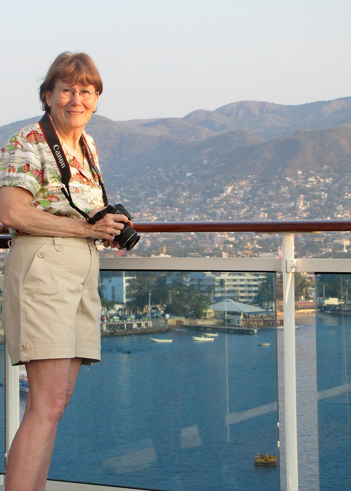 Susan on deck with Acapulco in background