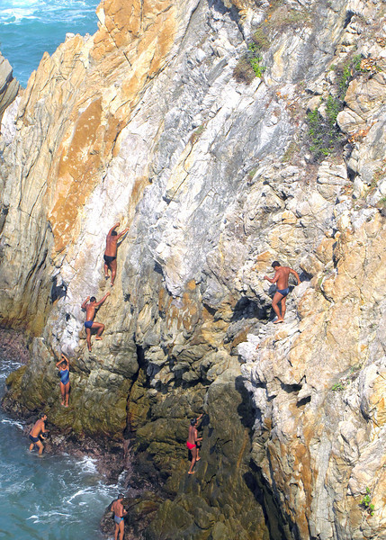 Cliff Divers climbing the cliff