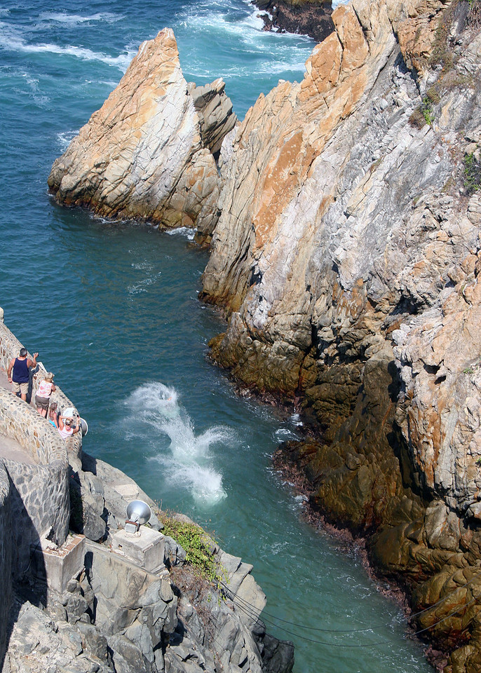 Cliff Divers splashes into the water