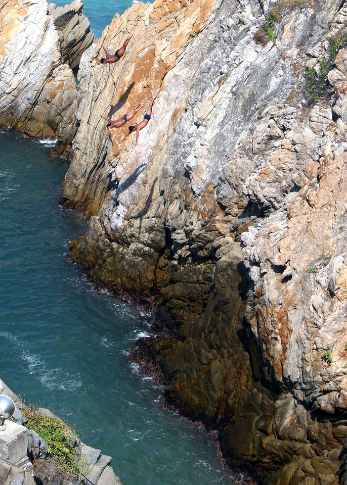 Cliff Divers on the way down.