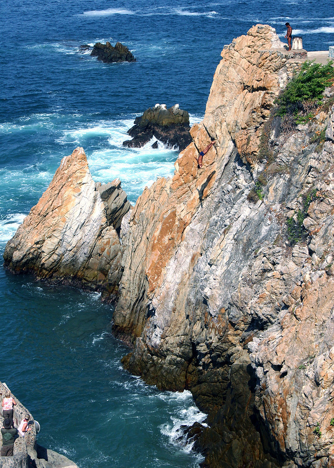 Cliff Diver on the way down.  Look just to the right of the large dark rock close to the cliffs and you can see the diver.