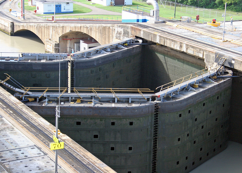 Pedro Miguel Lock.  Each chamber along the Panama Canal contains a pair of auxiliary gates which can be used to divide the chamber in two; this is designed to allow for the transit of smaller vessels — such as canal tugs — without using the full quantity of water.  You can see them here.<br /> <br /> They were originally incorporated because the overwhelming majority of all ships of the early 1900s were less than 600 ft in length, and would therefore not need the full length of the lock chamber. Nowadays these gates are rarely used; instead, small boats such as tour boats, tugs, and yachts are passed in groups.