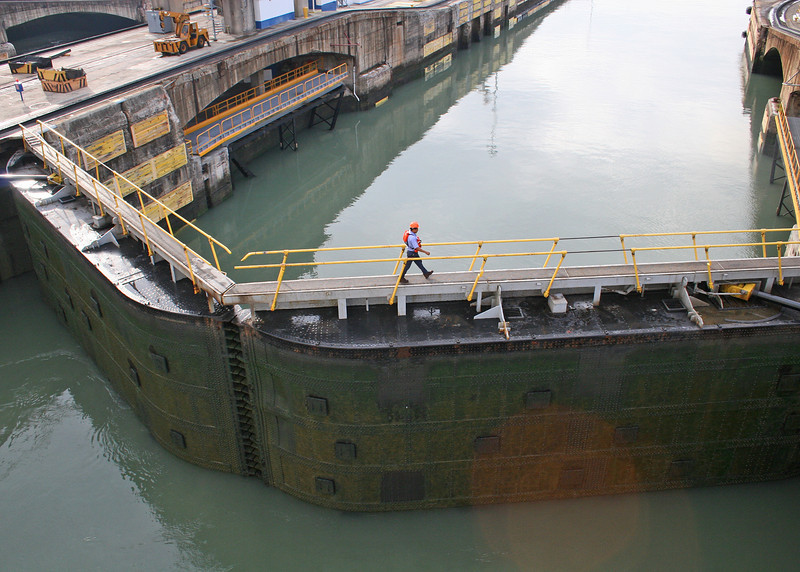 Miraflores Lock.  When the gate is completely closed, people can go across the gate.  The Panama Canal has a total of 46 miter gates, varying between 353 and 662 tons.