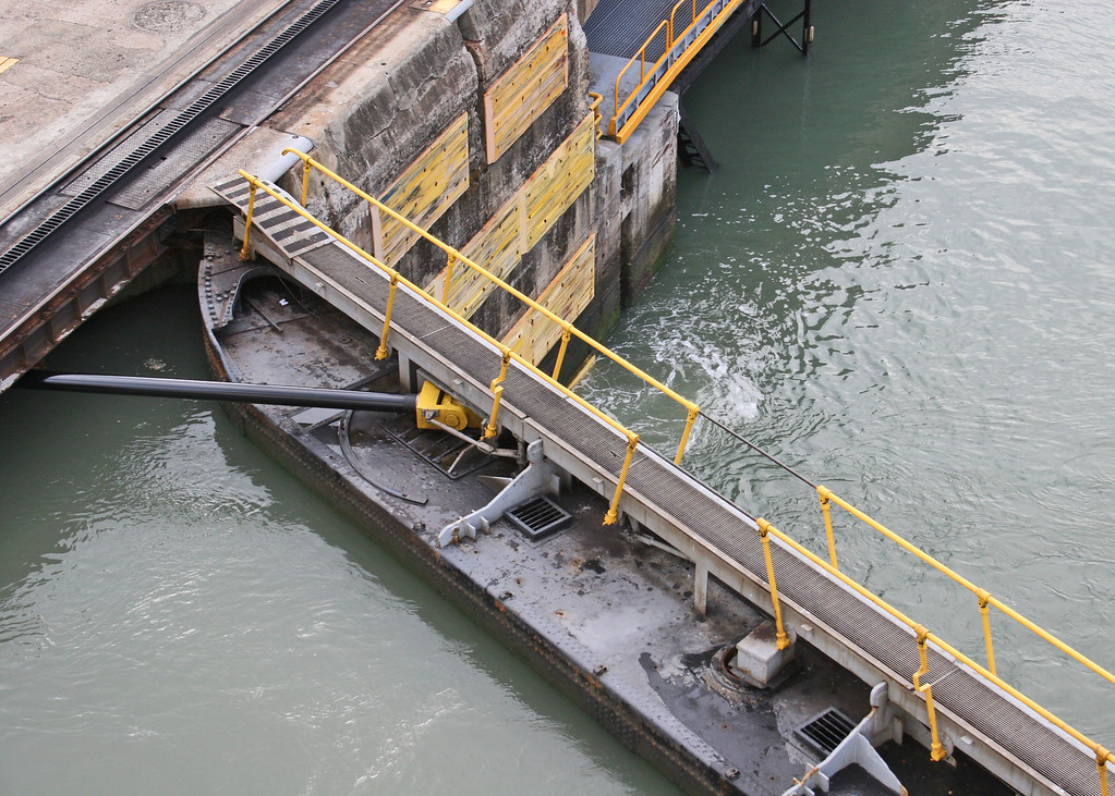 Closed gates at Miraflores Locks.  notice the depth of the water in the foreground compared to the depth of the water in the other lock.
