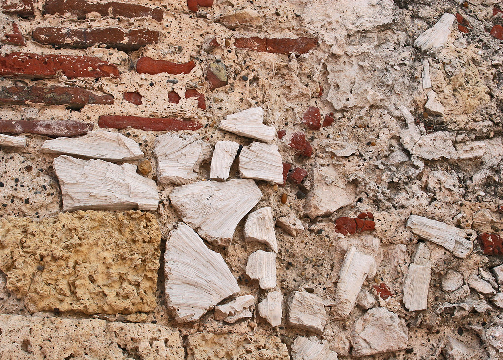 A close-up of the wall.  The wall around Old Town Cartegena - Las Murallas are fort walls that were built by the Spaniards.  The thick stone walls dating back to the 16th century encircle the old city.