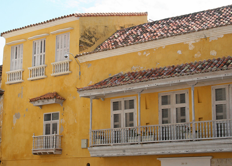 Old Town Cartegena has colonial architecture and is punctuated with balconies and flowers on many of the buildings