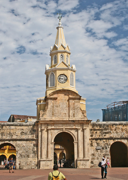 We entered the Old Town through the historic Torre del Reloj.  The Clock Gate is the symbol of Cartagena, and often, Colombia, as well! The center gate originally was the only opening into the Walled City. It led to an over water bridge and to the Walled Village of Getsemani. The left and right gates did not exist, but within these areas, and accessible from inside of the Walled City, were the Munitions Depot and a Chapel.