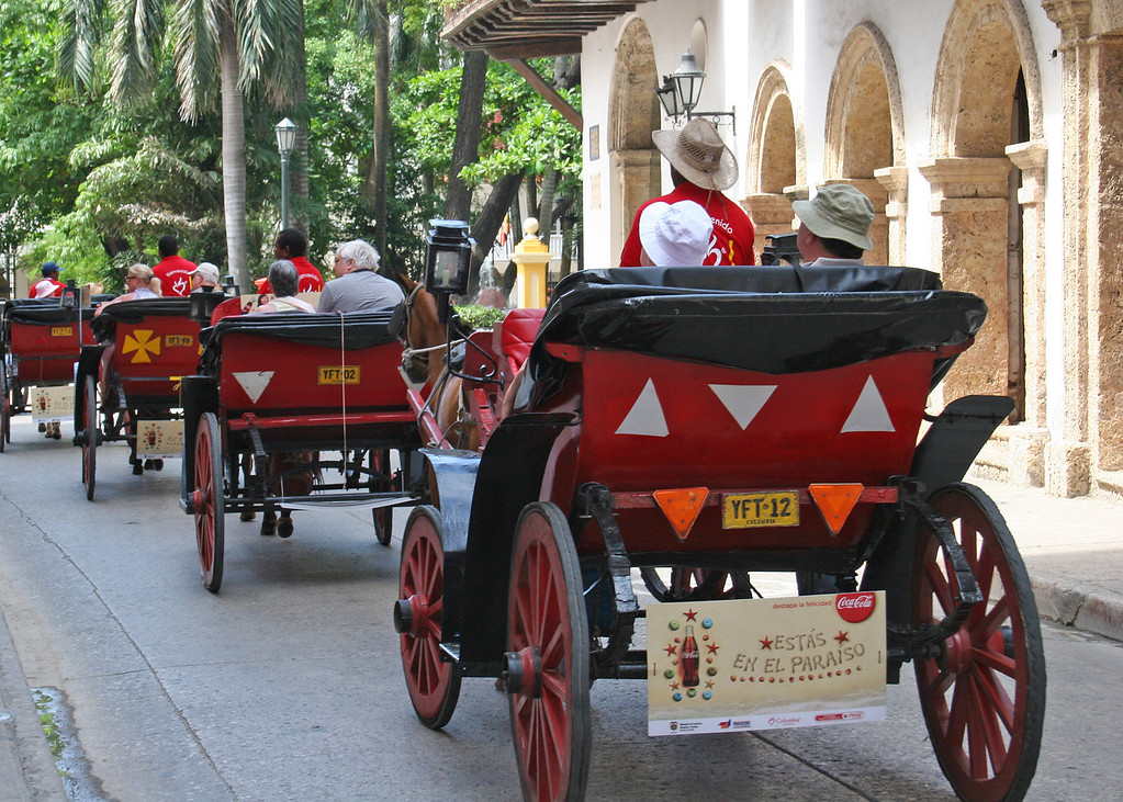 Horse drawn carriages give tourists a ride through Old Town