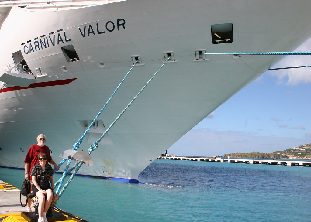 Mike and Susan on dock in front of their ship, Carnival Valor