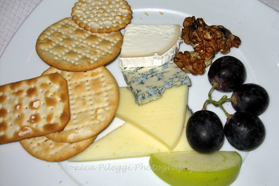 Assorted cheese and fruit platter for dessert