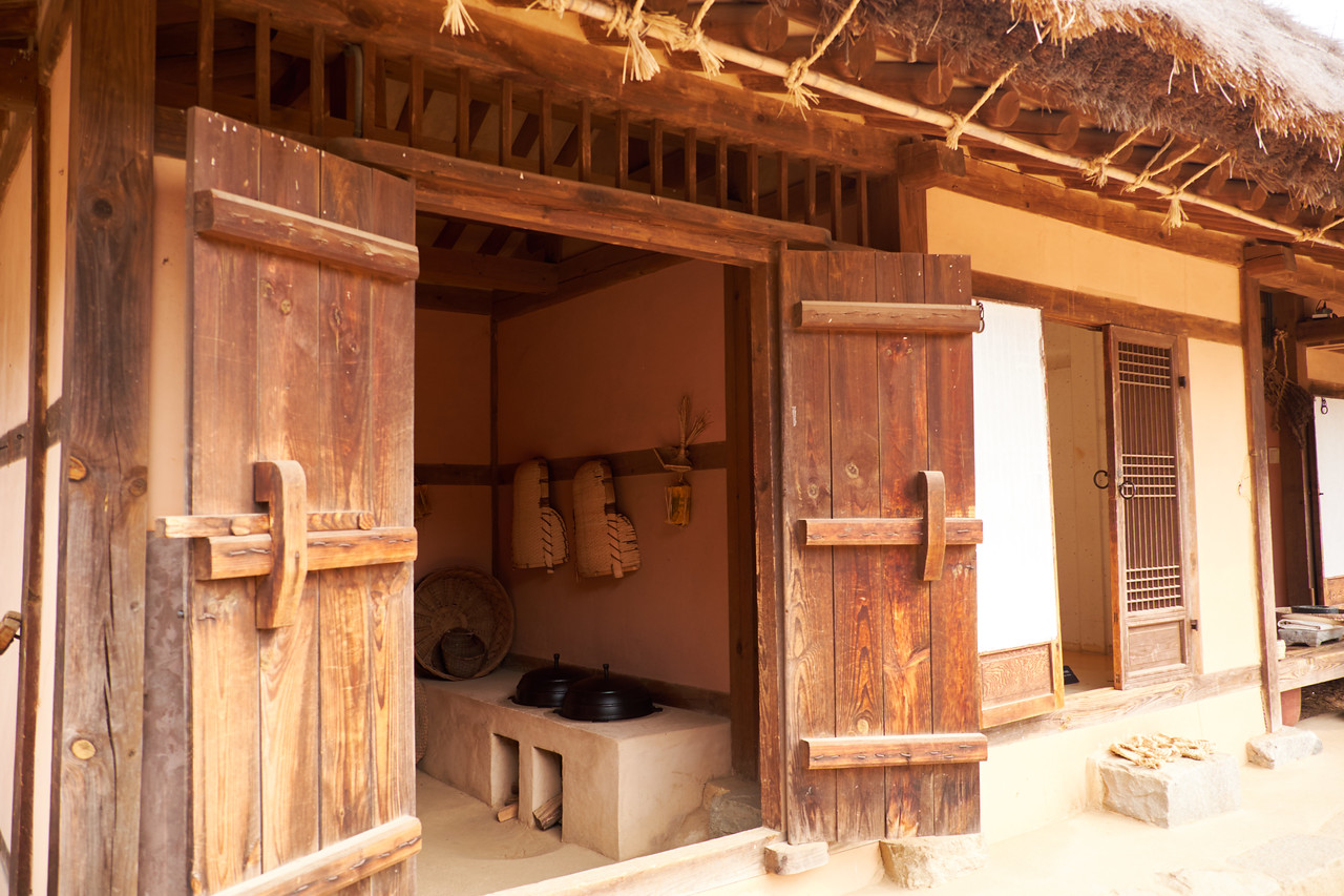 "The traditional Korean farmhouse has stone floors heated by an ""under system"" from the stove fire. The age of the roof is determined by the number of straw layers."