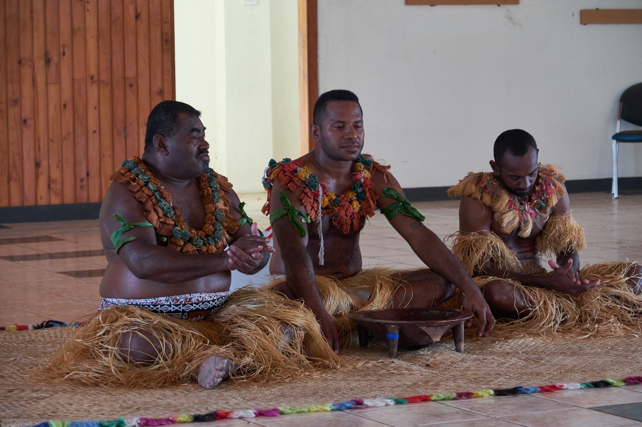 The men on each end clap three times and yell Bula (Welcome in Fijian).