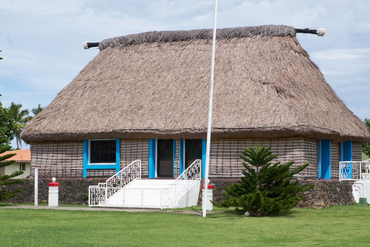 The Chief's Meeting House. The foundation is higher than all other houses in the village . Only a Chief is allowed to have decoratie shells as seen at the top of the roof.