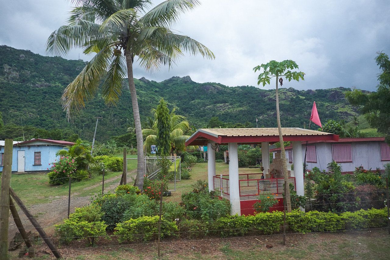 A home displying a red triangular flad signifies it is the home of a Hindu.