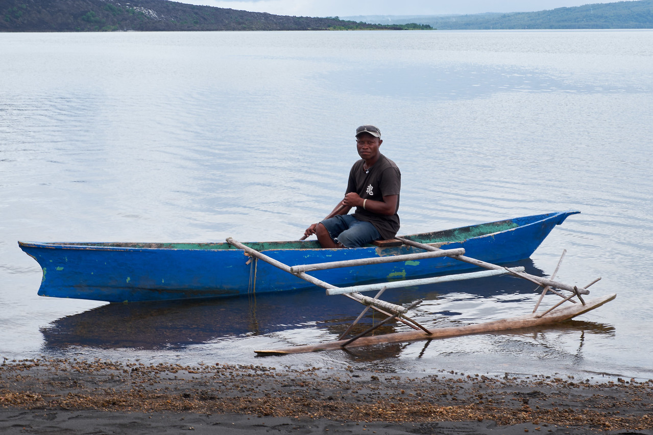 Local in a traditional fishing boat.