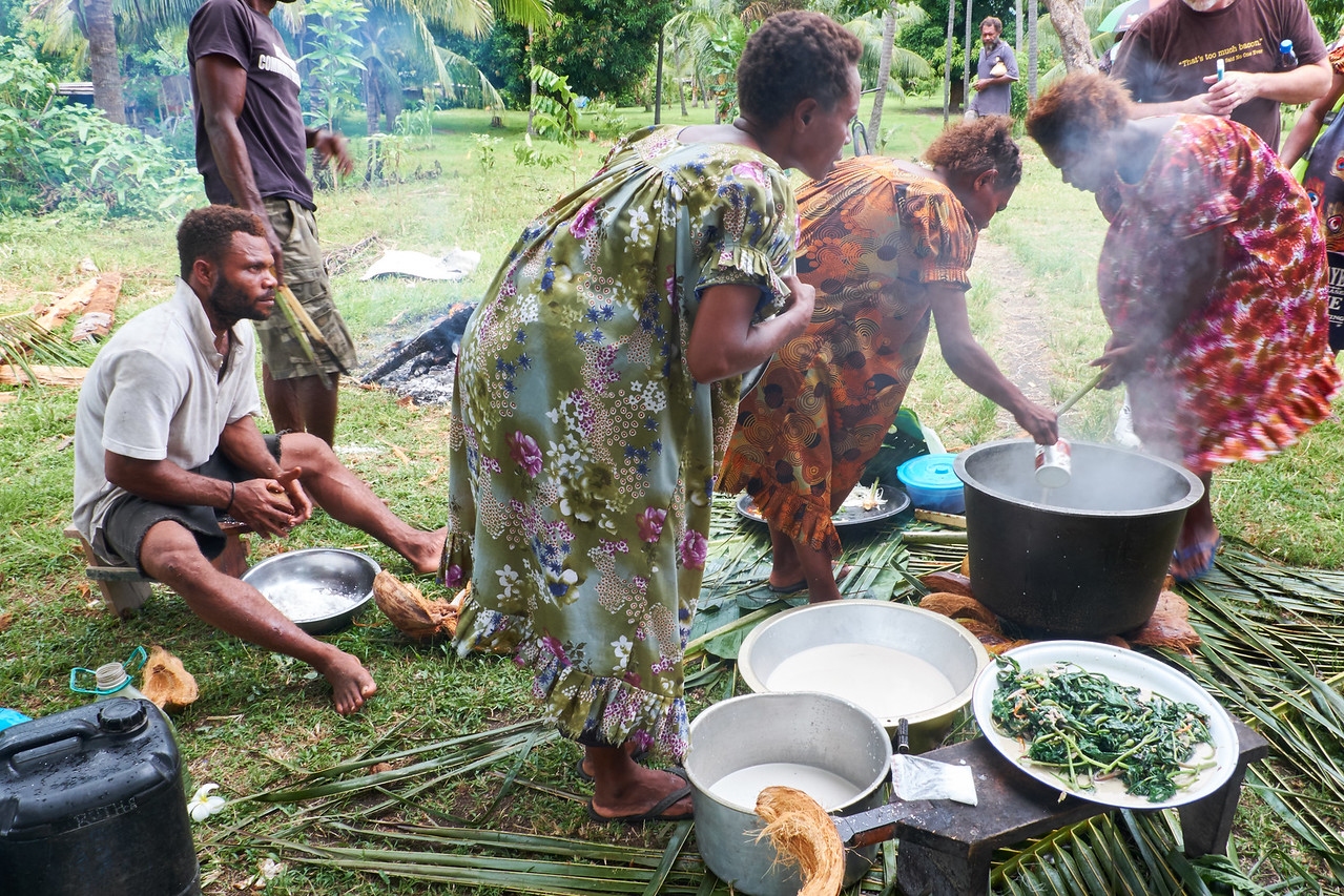 Cook local greens by heating stones to boil the coconut milk and greens.