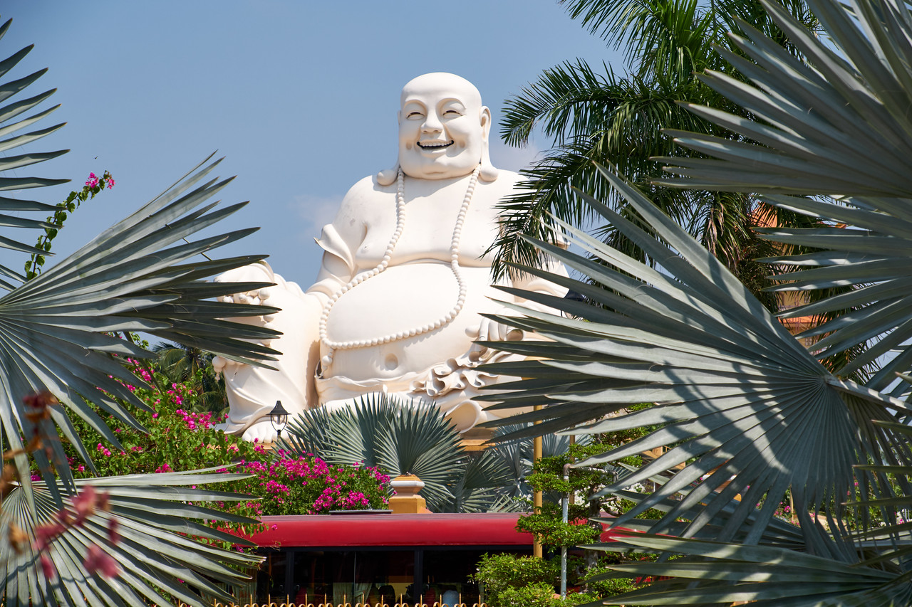 The Happy Buddha from outside the gates of Vinh Trang Pagoda.