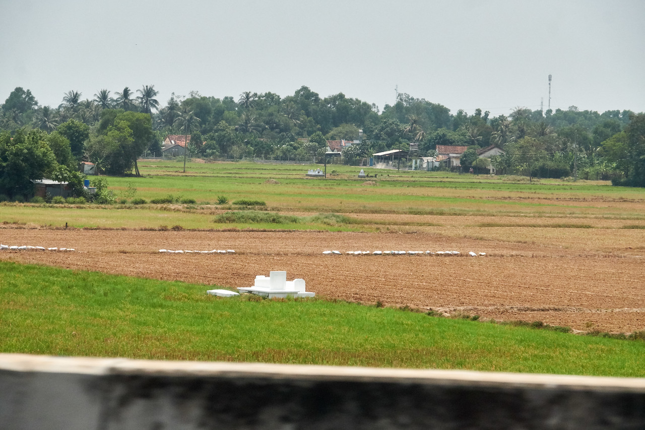 This is an example of individual ancester graves on the rice fields. Some feel this is why the rice is so plentiful. (from the car)