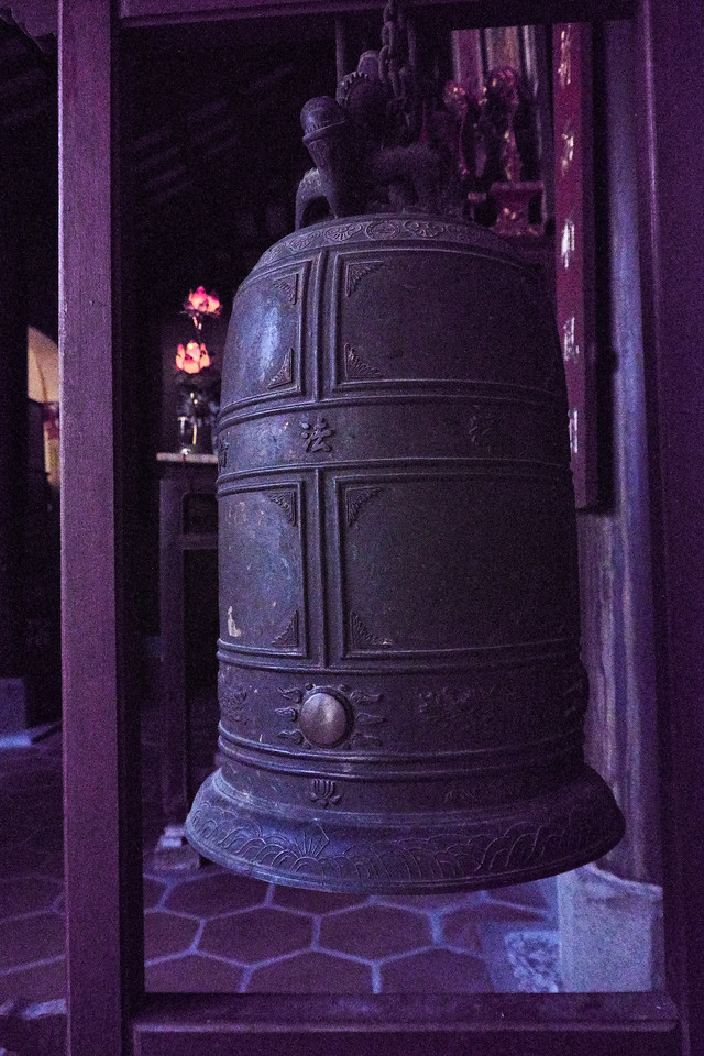 The bells are rung at night because the sound hurts the Devil's ears thus keeping him away from the Pagoda.