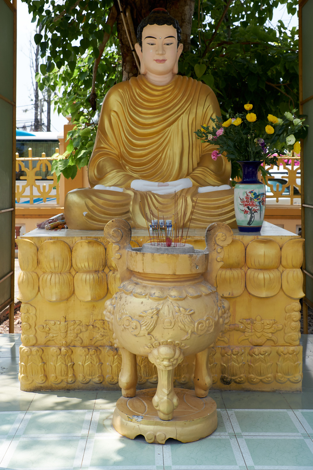 Bronze Buddha. Local people's goal is to achieve this Buddha's state.