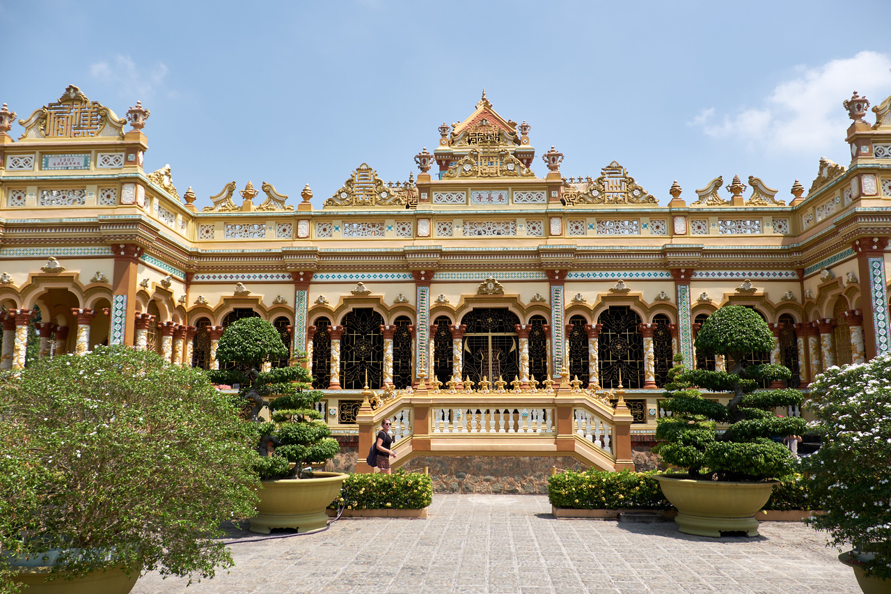 The front of the temple is designed in a style that mixes European and Asian architecture. French fleur de leis on the stairs.