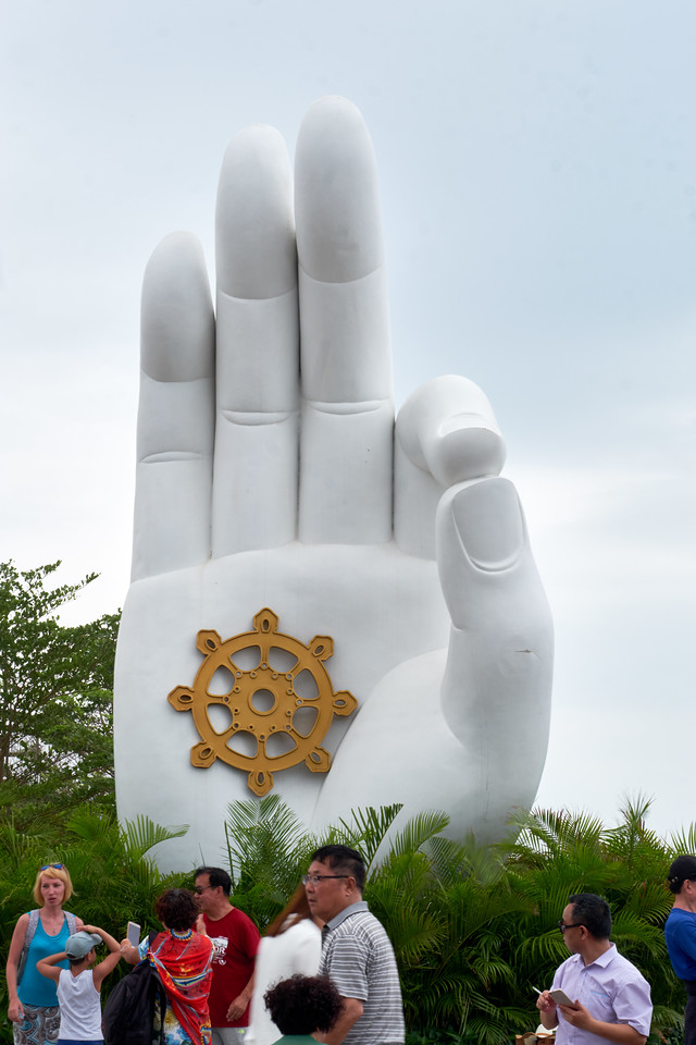The thumb and index finger grasp a fine object as a grain of truth. This is a symbol for spiritual understanding.