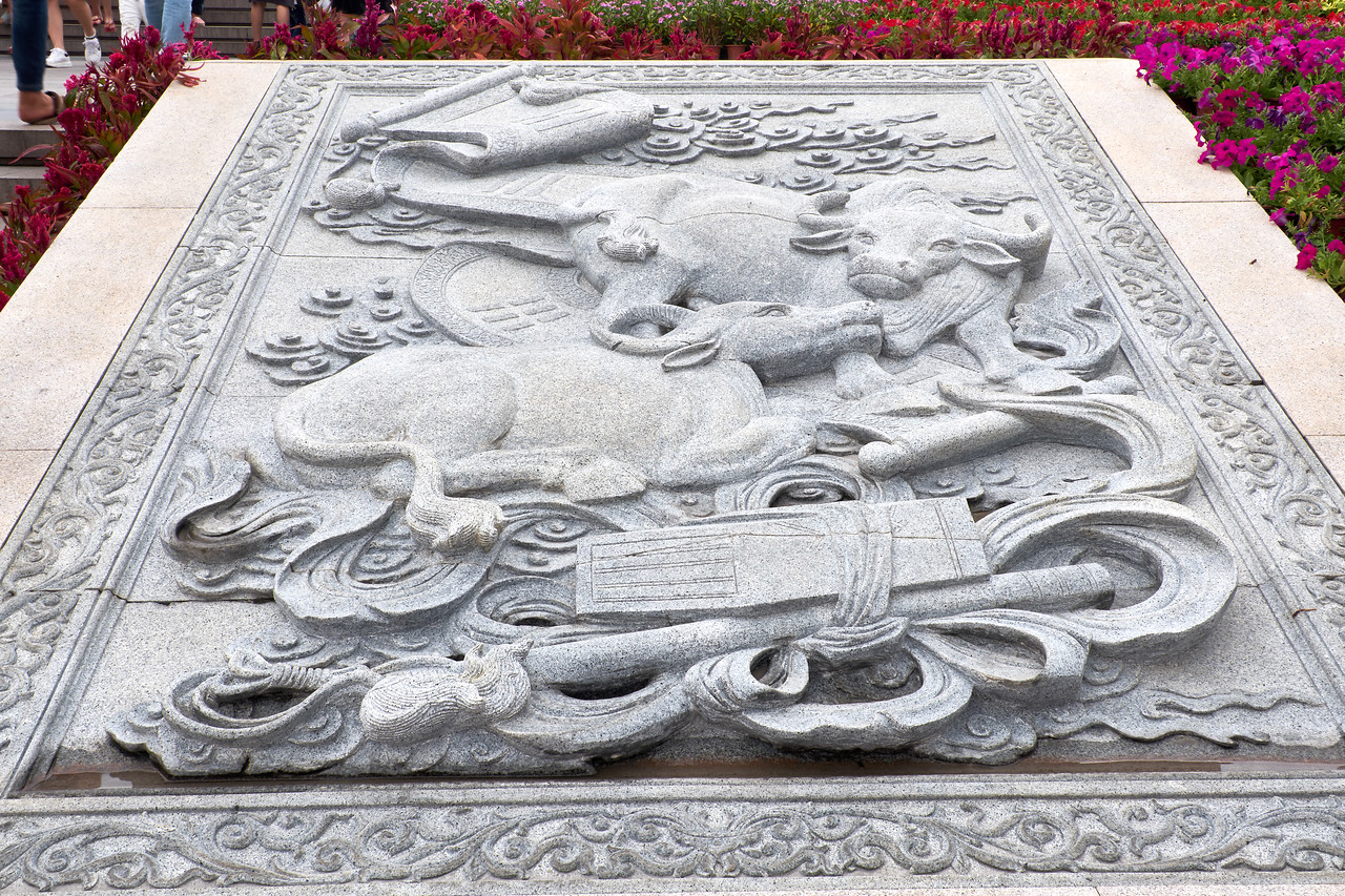 Cow cement relief on the way to the Guan Yin Statue. Cow is revered because the cow's milk saved the Buddha prince's life.