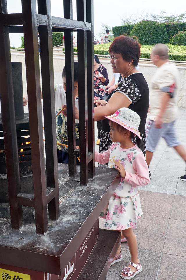 People of all ages were burning incense.