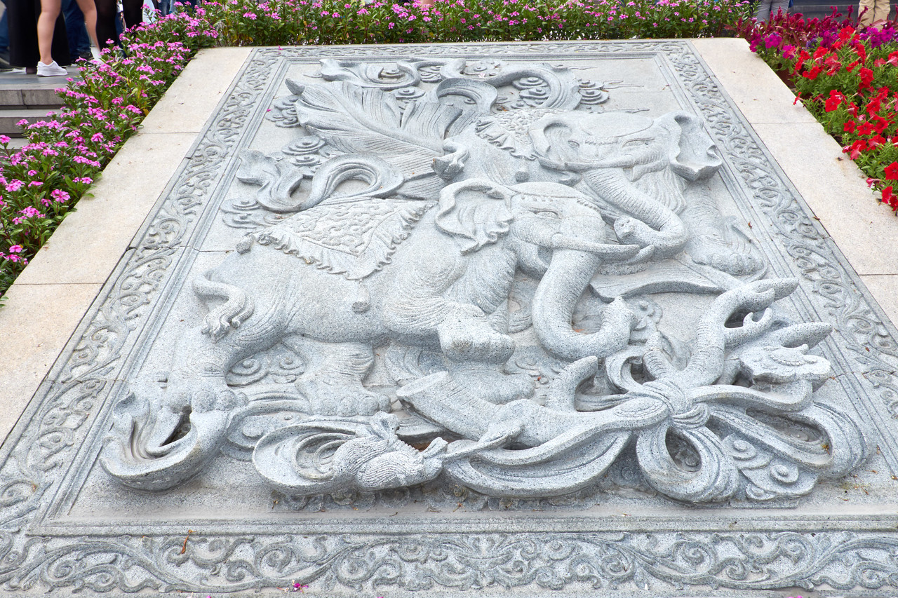 Elephant cement relief on the approach to the Guan Yin Statue. Elephant is a symbol of mental strength.