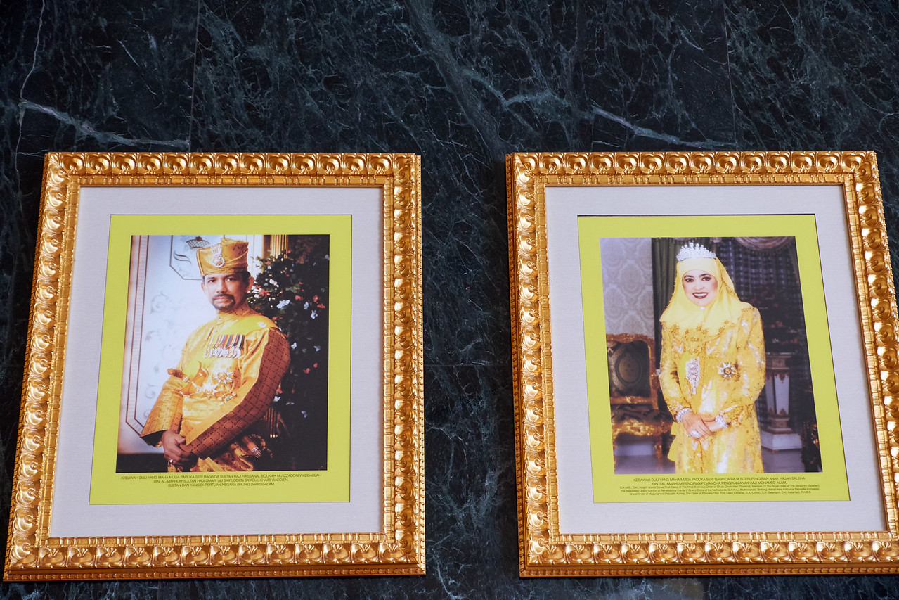 Sultan of Brunei (29th) and the Queen of Brunei (1st wife). These pictures hang in the lobby of The Empire Hotel.