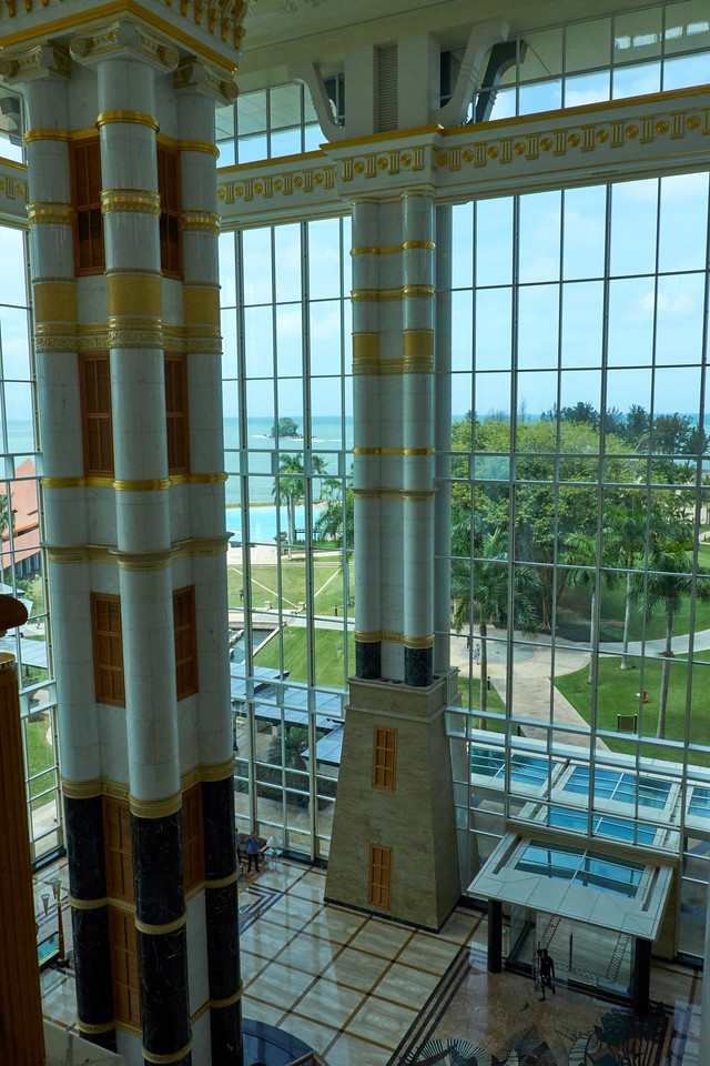 Interior shot of Empire Hotel owned by Sultan of Brunei. Looking out toward pool and South China Sea.